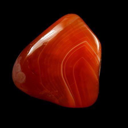 chalcedony: Red chalcedony (carnelian), isolated on black background