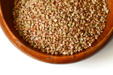 Uncooked buckwheat seeds close up shot