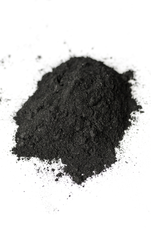 Activated charcoal powder shot with a macro lens Stock Photo - 68991937