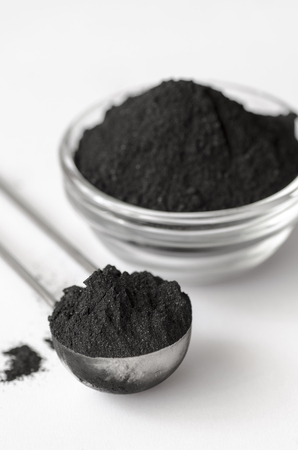 activated: Activated charcoal powder shot with a macro lens Stock Photo