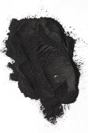 Activated charcoal powder shot with a macro lens 스톡 콘텐츠