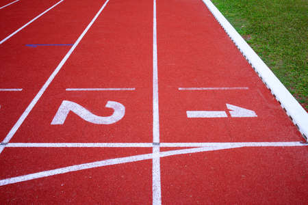 running track numbers one two in stadium photo