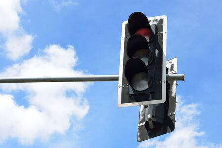 traffic signal: Red color on the traffic light with blue sky background