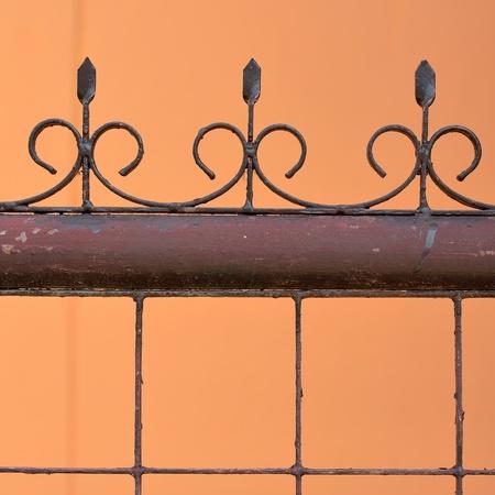 iron fence on orange background Stock Photo - 17099747