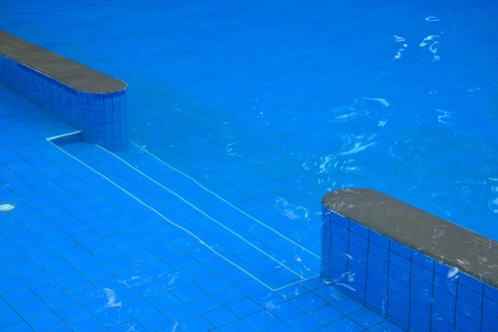 swimming pool blue water and wood flooring photo