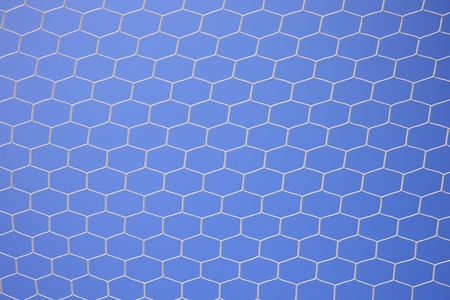 Soccer net on blue sky background photo