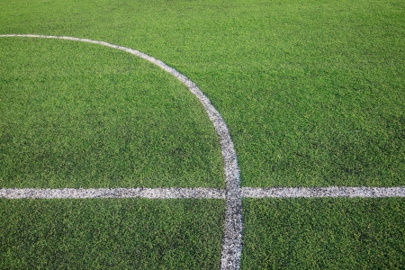 White stripe line on the artificial green grass field photo