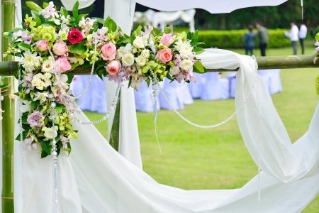 White flowers decorations during outdoor wedding ceremony photo