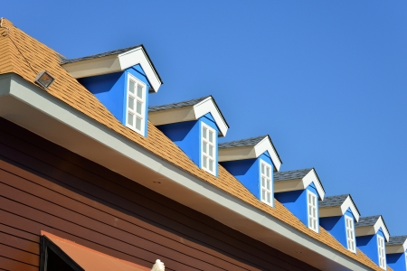 roof of house under blue sky photo