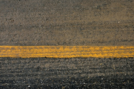 yellow line on asphalt road crack surface Stock Photo - 20535075