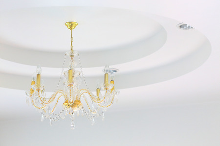 chandelier background: Luxury crystal chandelier on white wall background
