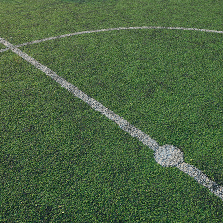 Artificial soccer field stadium on the green grass, sport game background for design photo