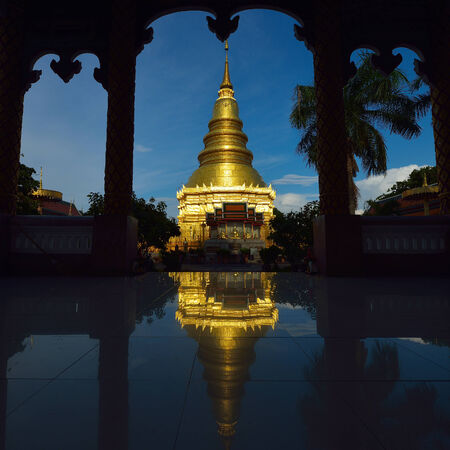 lamphun: Golden pagoda architecture of northern thailand in temple buddhism at Wat Phra That Hariphunchai, Lamphun, Thailand