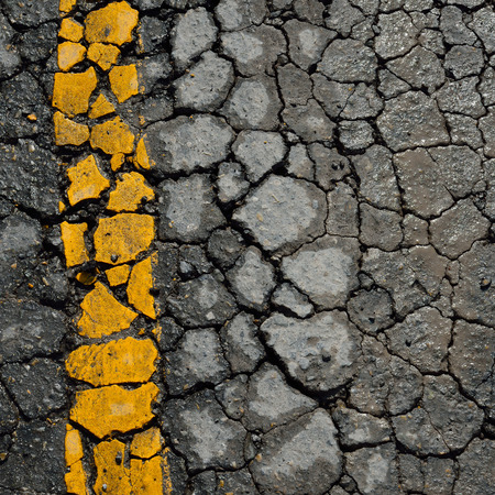 bumpy road: asphalt road crack texture background