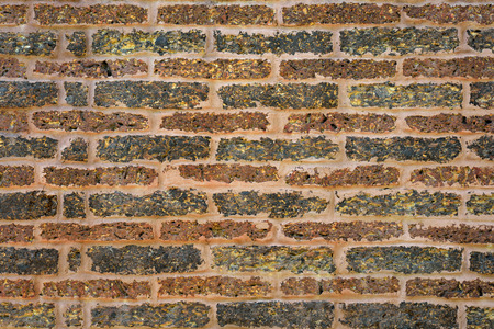 Wall made of laterite stone, laterite stone texture background photo