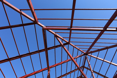 steelwork: residential construction home, steel beams with blue sky at construction site