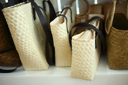 rattan bag on shelves photo