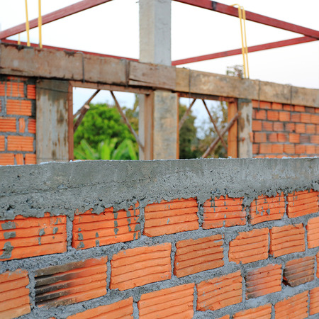 Building and Construction house, wall made red brick photo