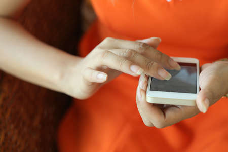 female using a smart phone, hand touch on screen digital tablet, shallow depth of field image photo