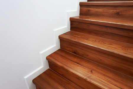 wooden staircase in a white modern house photo
