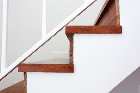 banister: wooden staircase in a white modern house