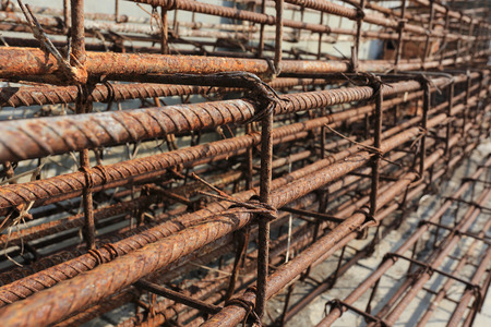 Steel rods used to reinforce concrete in construction photo