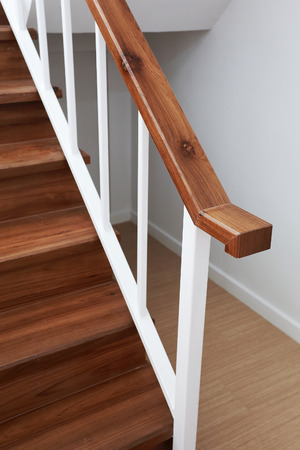 wooden staircase railing in a white modern house photo
