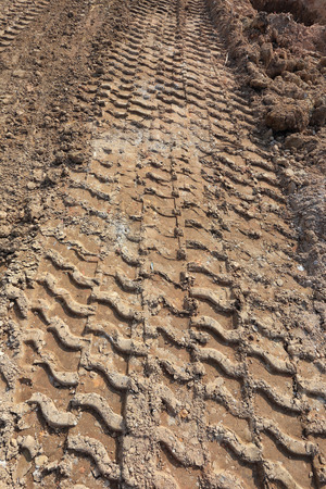 plowed field with tractor car tire track photo