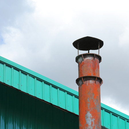 particulate: smokestack pollution with blue sky background