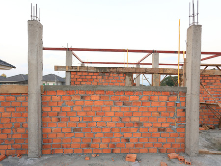 housebuilding: Building and Construction house, wall made red brick