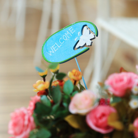 design of welcome sign and  blossom flowers photo