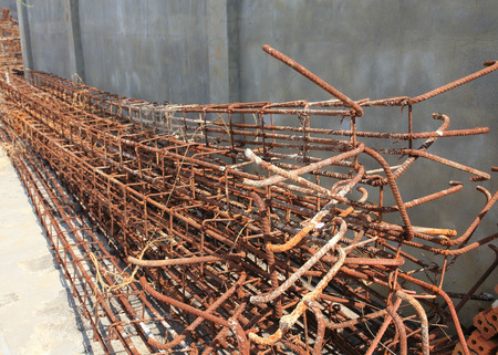 Steel rods used to reinforce concrete in construction site photo