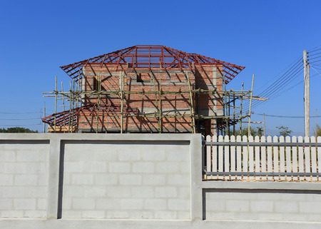 Building and Construction house, fence made concrete block photo
