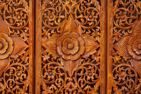 Pattern of flowers carved on wood photo