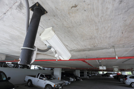 security camera in car parking of building