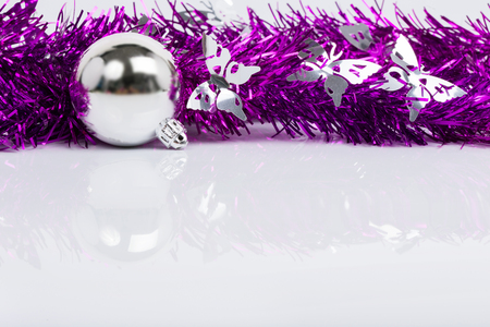Christmas background with silver ball ornament on white background photo