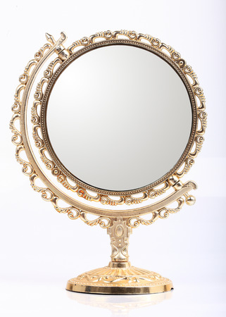 golden vintage makeup mirror isolated on white background photo