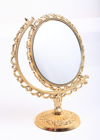 vanity: golden vintage makeup mirror isolated on white background