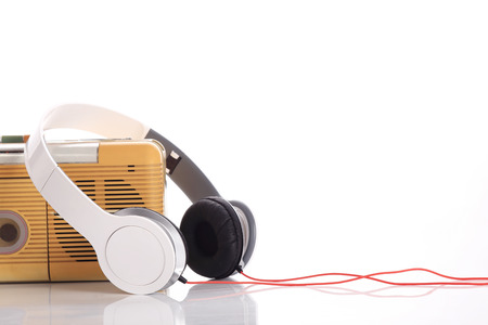 music radio and white headphone on white background photo
