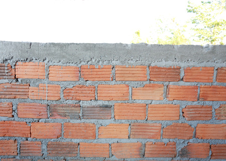 brick mason: brick wall in residential building construction site Stock Photo