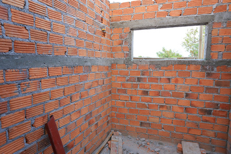 residential construction: brick wall in residential building construction site Stock Photo