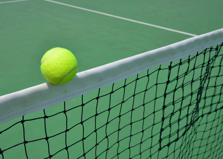 tennis ball on green court, sport background