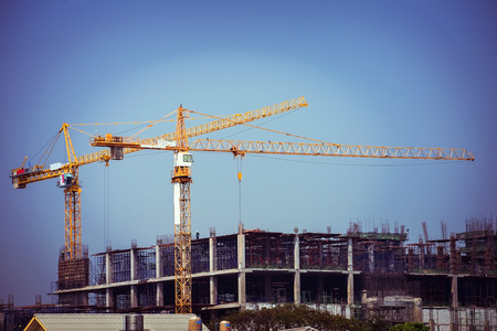 tools construction: crane construction industry background, retro tone image Stock Photo