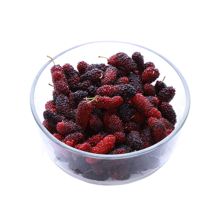 mulberry fruit in glass bowl isolated photo