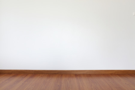 simple background: white mortar wall and wood floor in the room Stock Photo