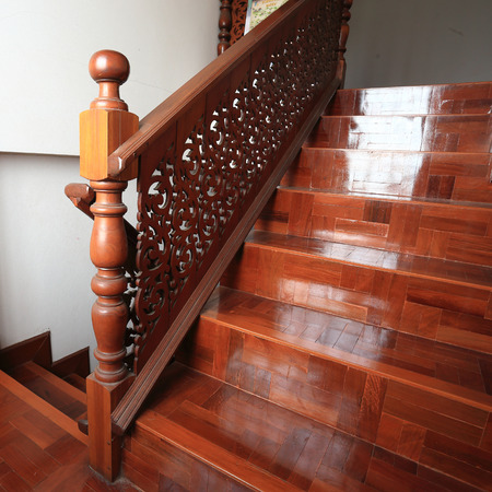 banister: wood staircase interior with parquet floor