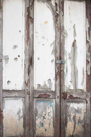 weathered: old white wood door weathered background