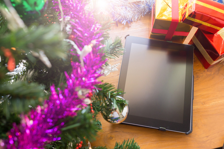 black tablet on table wood with christmas decoration photo