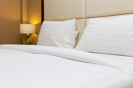 king size bed: bedroom interior with bed and lamp decoration