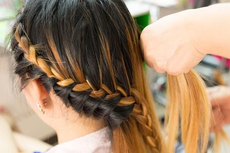 long braid creative brown hair style in salon beauty photo